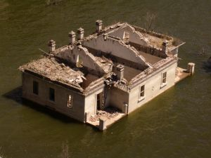 1064041_a_house_destroyed_by_the_flood.jpg