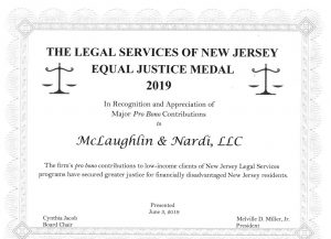https://www.newjerseylawyersblog.com/wp-content/uploads/sites/195/2019/09/equal-justice-medal.1-002-300x217.jpg